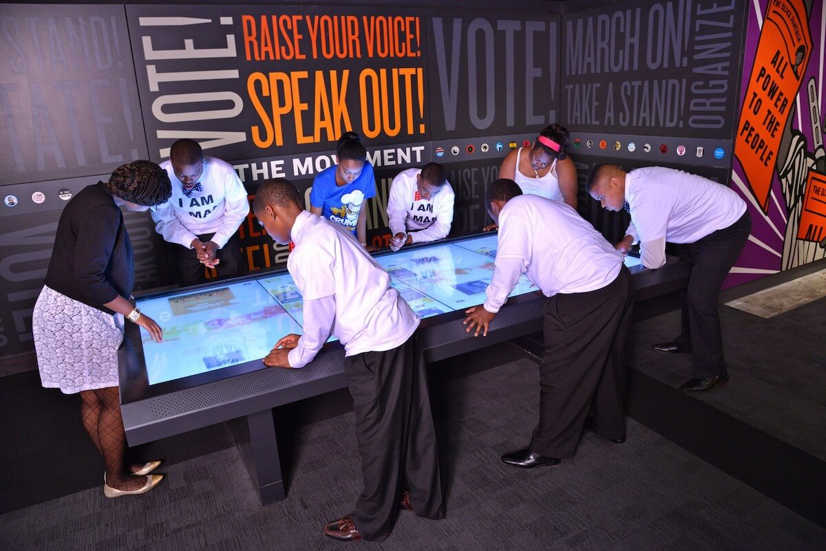 An interactive table is a great way to encourage guests to get involved with an exhibit.